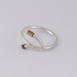 Silver twig shaped ring with hematite.
