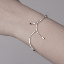 Silver bracelet twig with hematite.