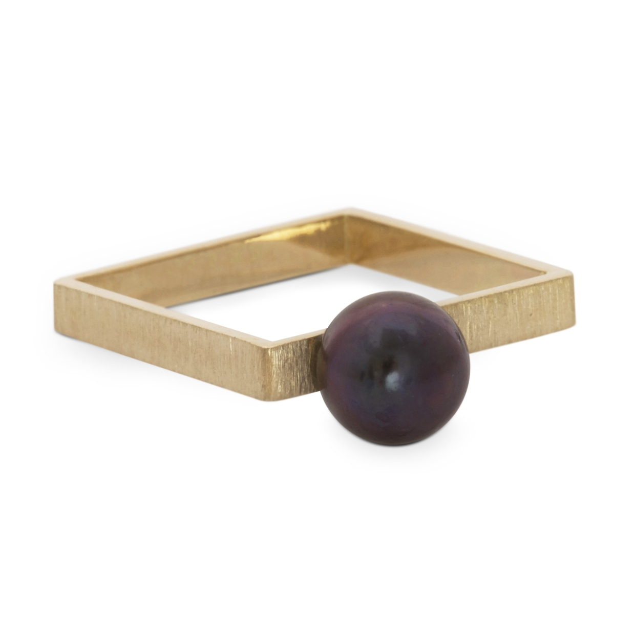 black pearl on a golden square