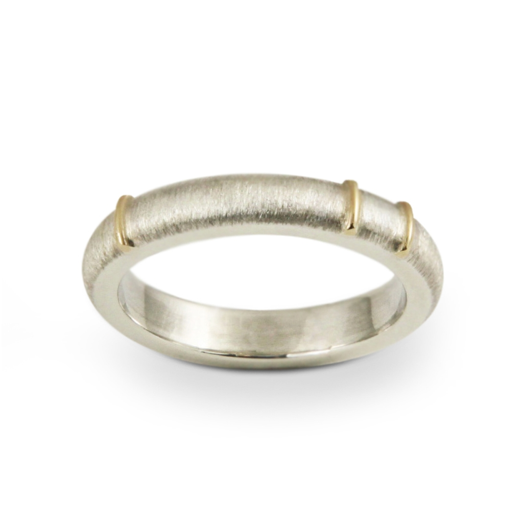 silver band marked with gold