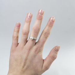 Silver ring with white pearl.