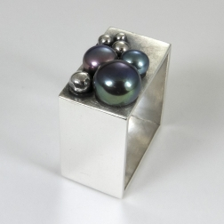 Wide ring with pearls.