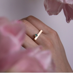 Gold square ring with emerald.