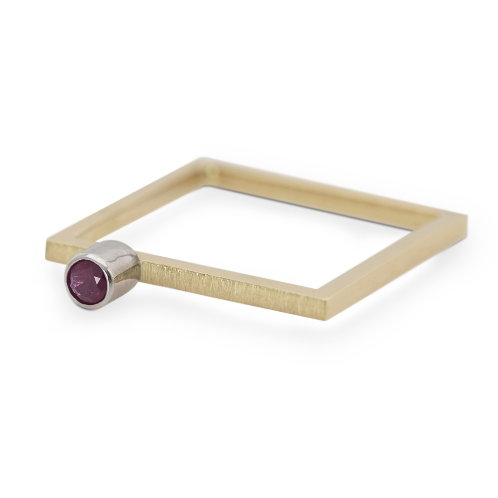 golden square with ruby - collection of strength and delicacy