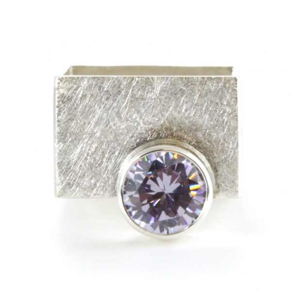 Wide silver ring with rhinestone.