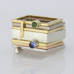 golden square with emerald collection of strength and delicacy