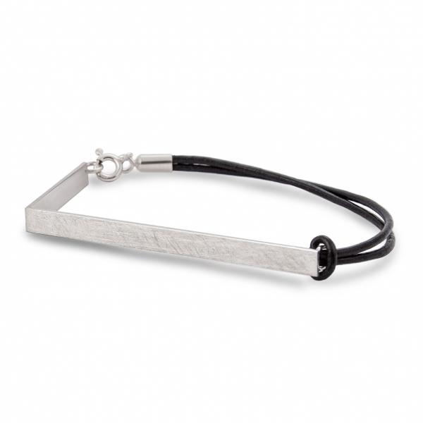 Silver bent bracelet.
